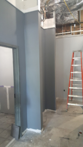 Primer paint and ceiling grid wall angle installed
